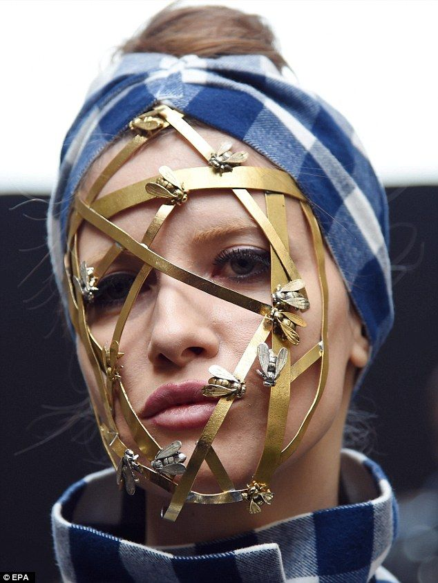 """TRIA ALFA in Daily Mail UK - Milano Fashion Week - Iulia Albu wearing our Bee-Mask. """"Interesting look: While most of the models sported simple, fresh-faced looks, one of the more intriguing beauty designs included a cage decorated with bees over the face"""""""