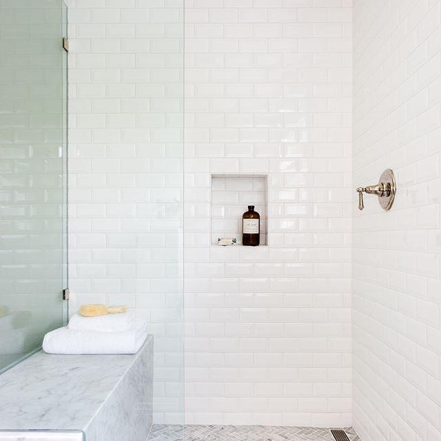 White Beveled Subway Tile Marble Wrapped Bench And Herringbone Floor Mosaic Transform This Mas White Beveled Subway Tile Herringbone Floor Beveled Subway Tile