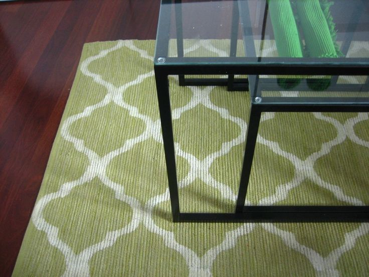 Another painted rug!  What a great way to save money and still get an awesome piece!