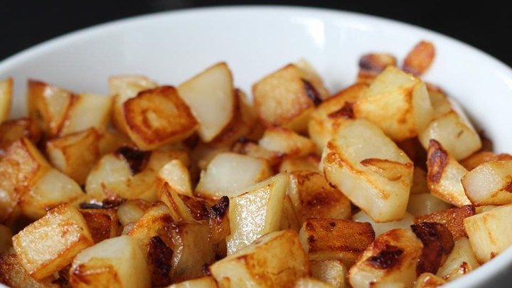 Diced potatoes get brown and tasty when cooked with butter on the stovetop.