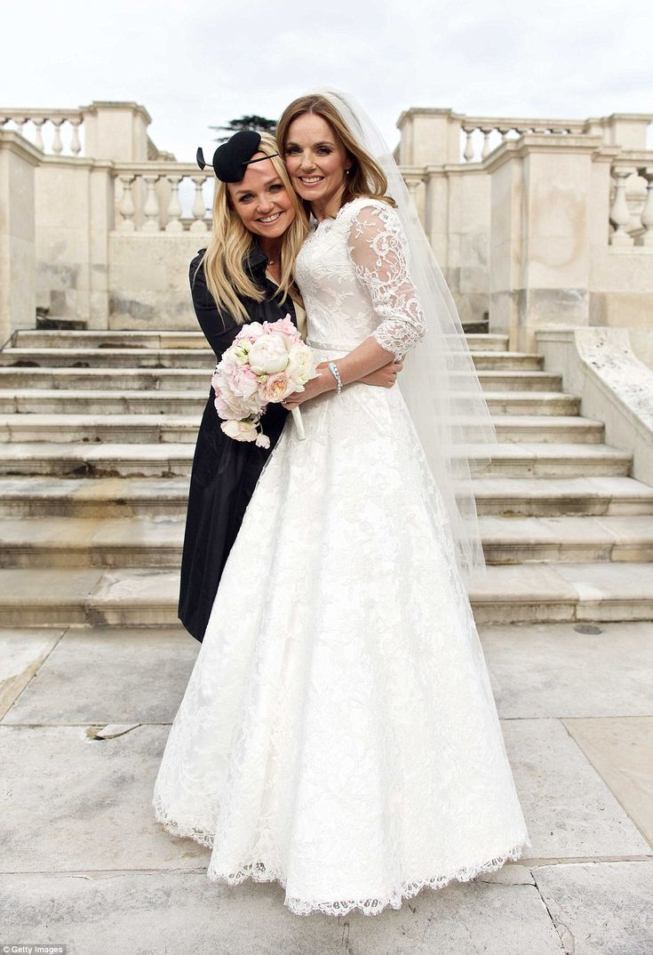 Friendship never ends: Geri's fellow Spice Girl Emma Bunton beamed with joy as she hugged the blushing bride on her big day