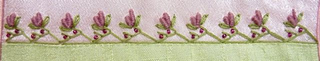 https://flic.kr/p/e34rVQ   TAST #52 - Triangular Feather Stitch   Green stitching done with 2 strands of floss. The bullions were done with 3 strands of floss. Tiny beads accent and finish off the seam. I liked this stitch for places where you want a narrow stitching on only one side of a seam.