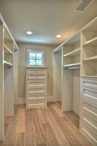 Walk-in closet with a window love the natural light. Love the extra storage drawers too.