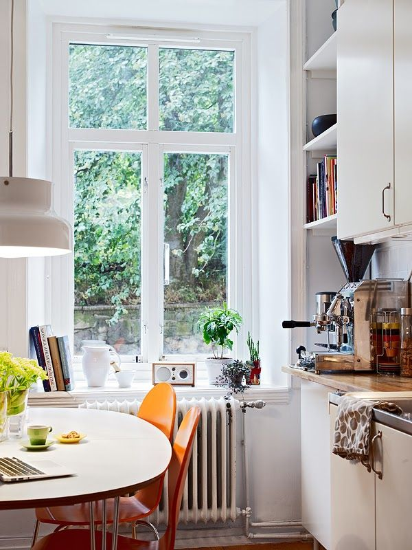 I love the simplicity of this kitchen so much I want to be sitting at that table drinking a coffee while looking out the window!