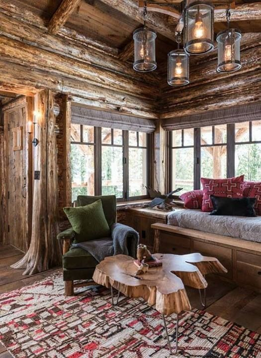 Love the windows and the log slice coffee table.