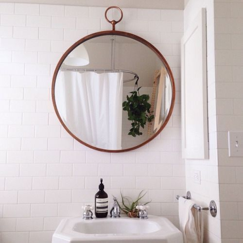 Round Mirror Above The Bathroom Sink