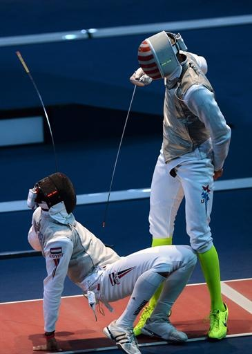 2012 London Olympics - CBSSports.com News, Medal Count -     American fencer Miles Chamley-Watson puts Eygyptian Alaaeldin Abouelkassem under pressure during their foil bout on Tuesday in London.