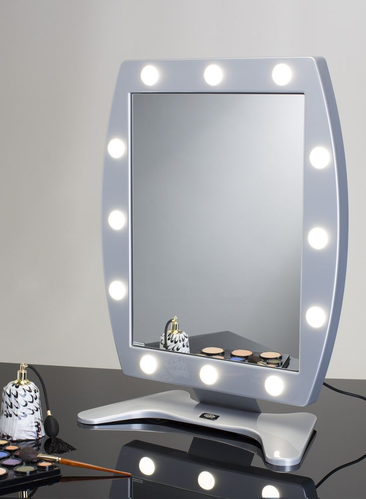 MDT MAKEUP TABLE MIRROR WITH 12 LIGHTS 470x650. Makeup Vanity Mirrors. Cantoni for makeup artist,  makeup schools, and professionals. The modern and refined design, the minimum bulk and the exclusive light system specific for an excellent yield of colors makes this mirror perfect for beauty salons, hairdressers, shops. #makeupmirrors #refined #design