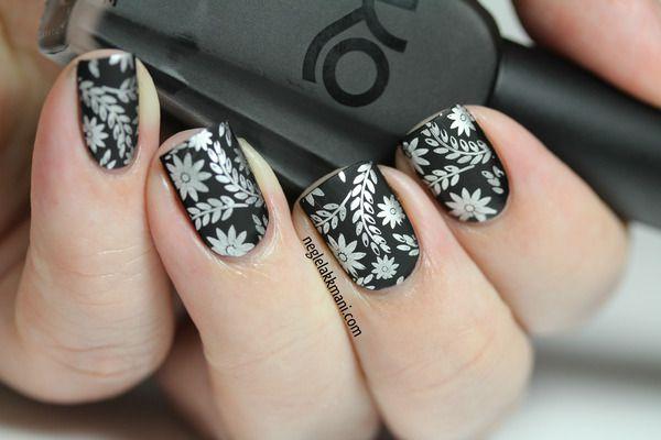 Silver art on matte black nails