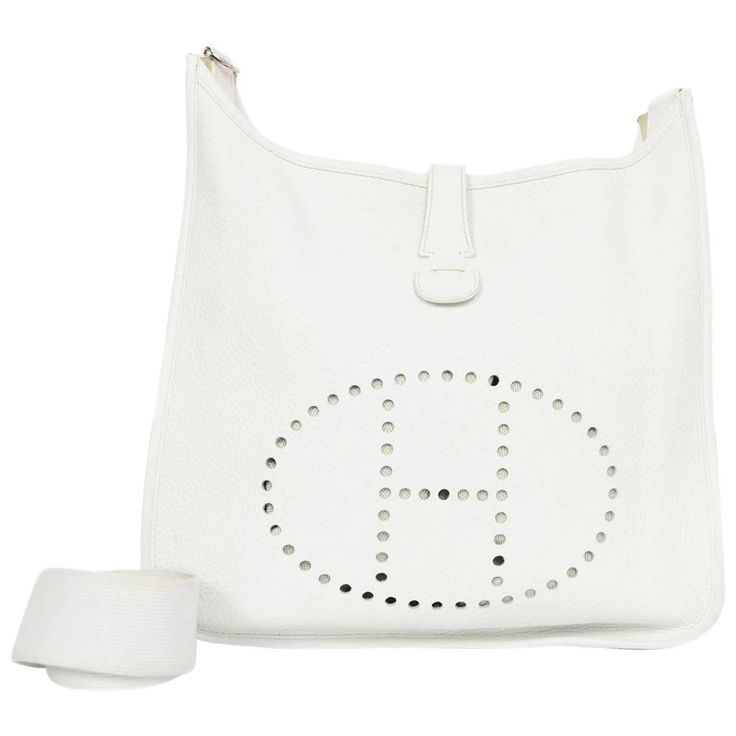 Hermes White Clemence Leather Evelyne III GM Crossbody Messenger Bag | See more vintage Crossbody Bags and Messenger Bags at https://www.1stdibs.com/fashion/handbags-purses-bags/crossbody-bags-messenger-bags in 1stdibs