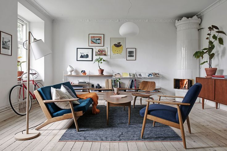 Colourful & fresh living room filled with a mix of contemporary & mid-century modern furniture
