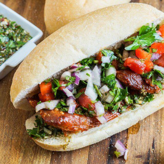 Choripán- Argentinian Chorizo Sandwich with Salsa Criolla and Chimichurri