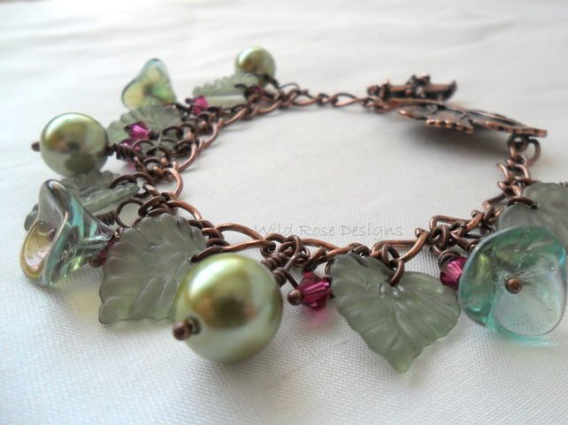 Woodland themed Charm style bracelet in green and fuchsia. £15.00