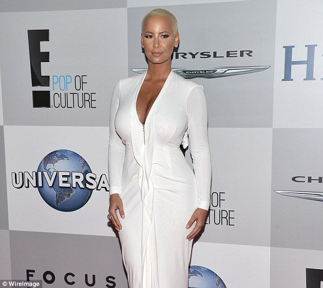 Hitting back: Amber Rose got involved in the Twitter spat between ex Kanye West and her estranged husband Wiz Khalifa on Wednesday (pictured at the Golden Globes on January 11)