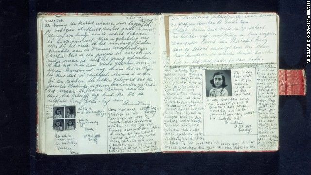 """Pages with text and photos from Anne Frank's diary, written in October 1942.The diary that Anne had received for her 13th birthday, which she had kept up during their time in the """"secret annex,"""" and which she had revised during her family's last few months in hiding, has outlived her by decades. It has become a classic of world literature, translated, reprinted and read throughout the world."""