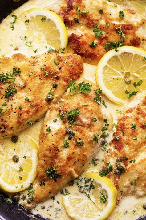 Creamy Lemon Chicken Piccatta 4 whole Boneless, Skinless Chicken Breasts salt and pepper to taste ¼ cup all purpose flour 2 Tablespoons Butter 2 Tablespoons Olive Oil 1 cup chicken broth 2 whole Lemons ¾ Cup Heavy Cream ¼ cup capers Chopped parsley, for garnish 1 pound Angel Hair Pasta