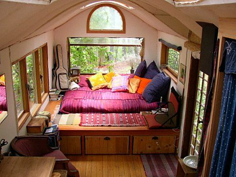 inside 8x20 and built on a stripped down truck chassis great tiny house
