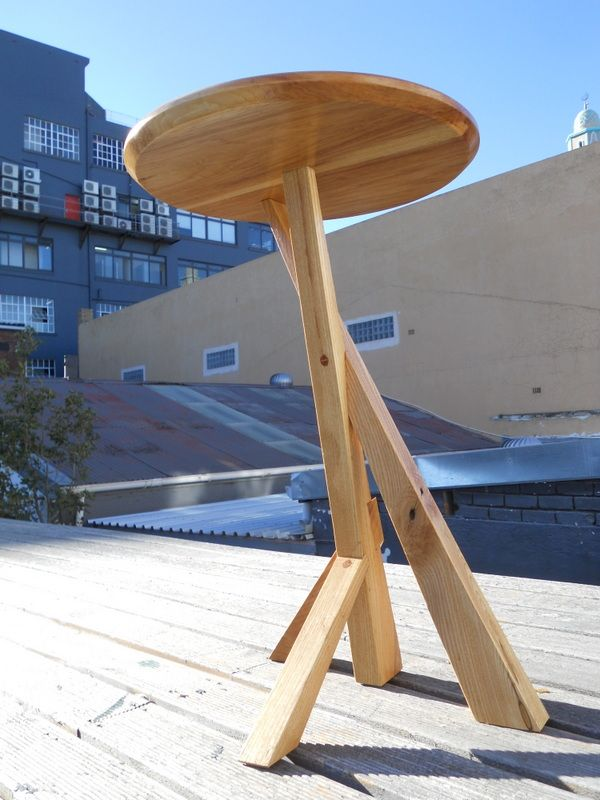 Assymetric side-table with ash legs and a hickory top.