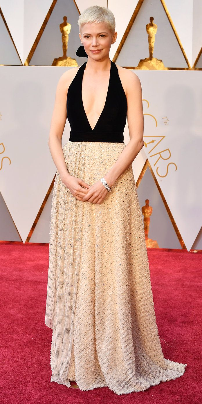 MICHELLE WILLIAMS IN LOUIS VUITTON  I love this black and white combination, which hits all the right notes for the evening's trend for texture. A silk velvet halter combined with a tulle skirt embroidered with pearls, crystals, and studs offers a contrast of soft and hard that could serve as a metaphor for Williams in her nominated Manchester by the Sea role.