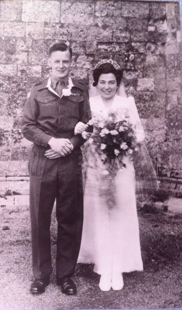 Mum and Dad on their wedding day at Christchurch Priory, Christchurch, England. May 4, 1946