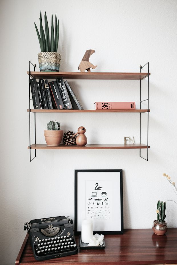 3 elements - books, plants and quirky objects all combine for a unique 'shelfie'