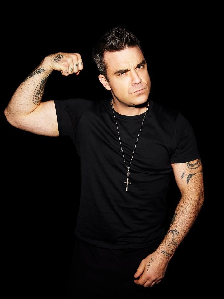 ROBBIE WILLIAMS Born Robert Peter Williams on February 13,1974 in England.