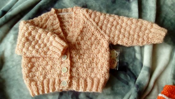 100 % wool girls cardigan,6 mths. pretty pale orange with texture pattern. Lovvely and warm, machine washable, hand knitted | Shop this product here: http://spreesy.com/LittleKiwiKnits/8 | Shop all of our products at http://spreesy.com/LittleKiwiKnits    | Pinterest selling powered by Spreesy.com
