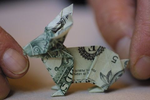cute origami rabbit made from a dollar bill