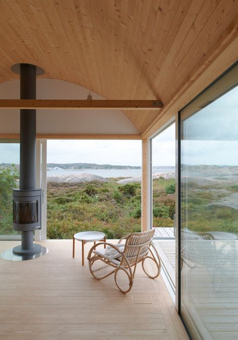 Summer house on stilts by Mats Fahlander nestles into the landscape of a Swedish fjord