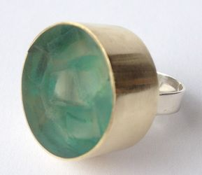 Glass and brass ring