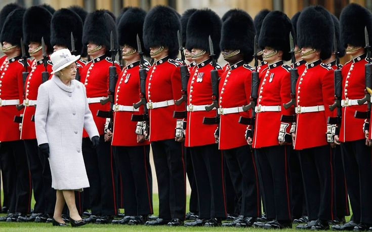 The Queen inspects troops during a ceremony to present new colours to the Coldstream Guards at Windsor Castle