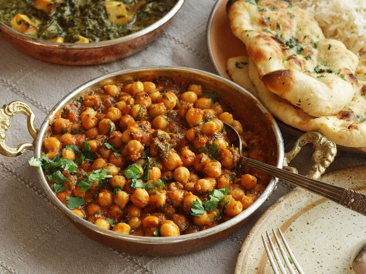 Channa Masala—one of the most popular dishes in the world, both in and out of India and Pakistan, —chickpeas cooked in a spicy and tangy tomato-based sauce.