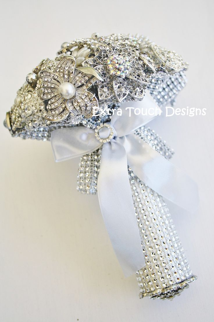 Brooch bouquet with silver mesh collar and handle