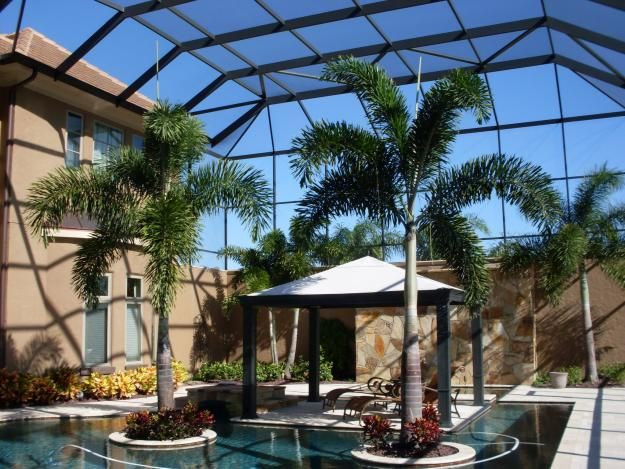 25 best ideas about screened pool on pinterest tropical for Florida house plans with lanai