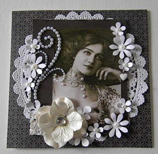 elegant and feminine heritage page with a gorgeous photo frame of paper doilies pearl studded flourishes and dimensional flowers