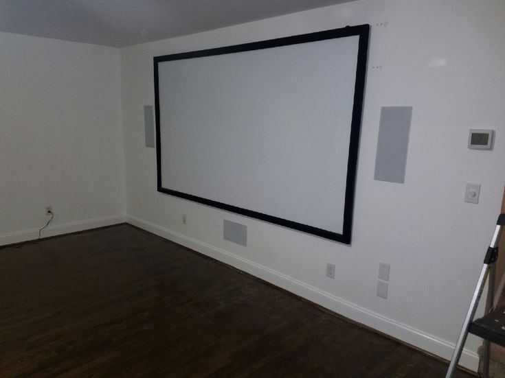 Home theater setup with in-wall speakers installed by Carolina Custom Mounts in Charlotte, NC.