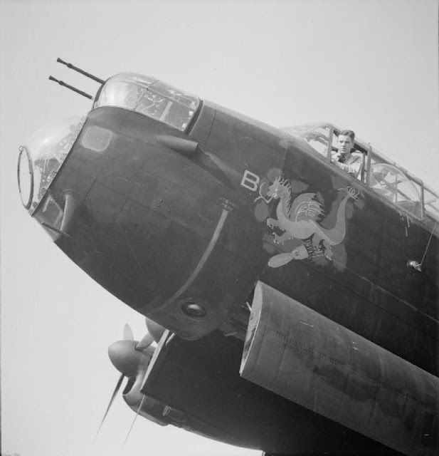 A dragon emblem on the nose of a Avro Lancaster Mark I