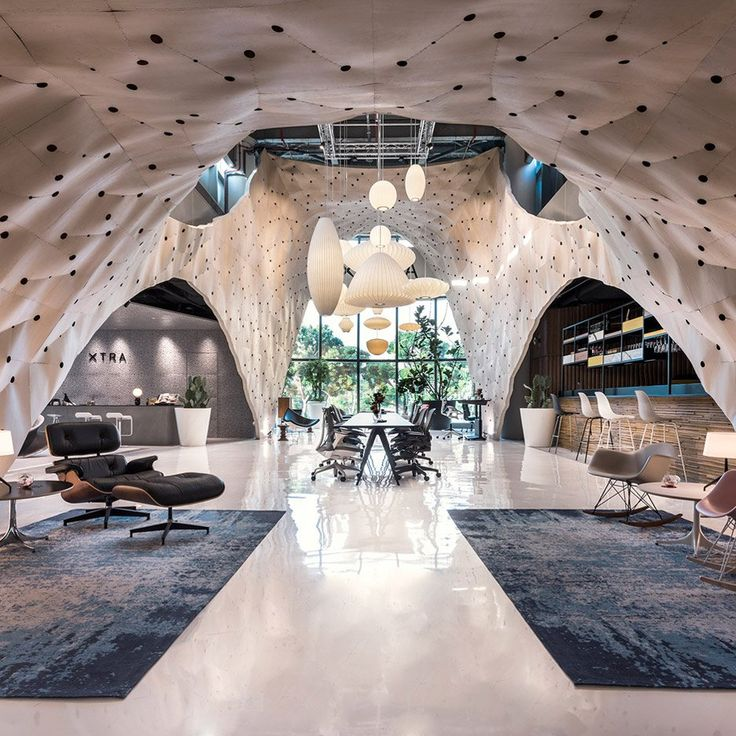 A moulded plywood pavilion built within a Singapore furniture store has won the title of World Interior of the Year at Inside festival 2017.
