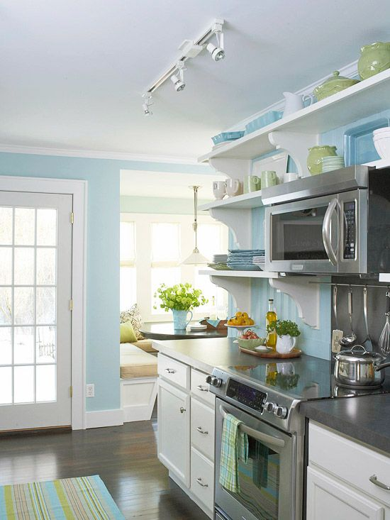 Before and after cottage kitchen open shelving nooks for Blue kitchen cabinets with yellow walls