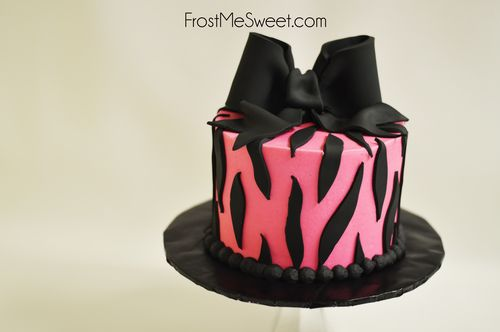 Pink and black zebra print cake with bow
