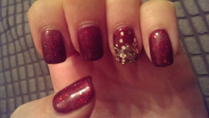 My christmas nails.. red fine glitter and gold chunky glitter accent