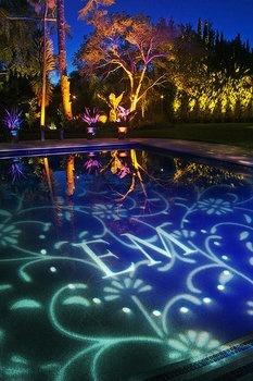 Monogram reflected into pool.