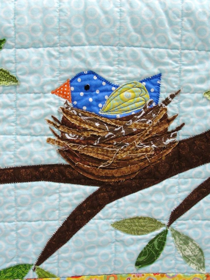 """Mama and her nest sit on a leafy branch. The branch is stitched down smoothly, and the leaves are raw-edge appliqued. Mama's eye is hand-embroidered, and her body is stitched down smoothly. Her wing is raw-edge appliqued, as is her nest. I love the effect of the """"twigs"""" in the nest! I completed a custom nursery wall quilt this week and made a nest like this for one of the branches- and I just had to make these small quilts to repeat the design!"""