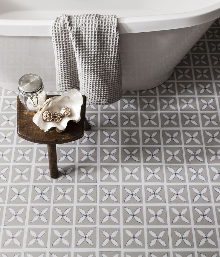 We love the pretty floral silhouette print of our Dee Hardwick vinyl floor tiles! Perfect for creating a subtly feminine look in the bathroom, or any other room in the home! Shown here in a soothing shade of Pebble Grey  http://www.harveymaria.com/Floor-Range/dee-hardwicke-for-harveymaria/lattice-pebble-grey