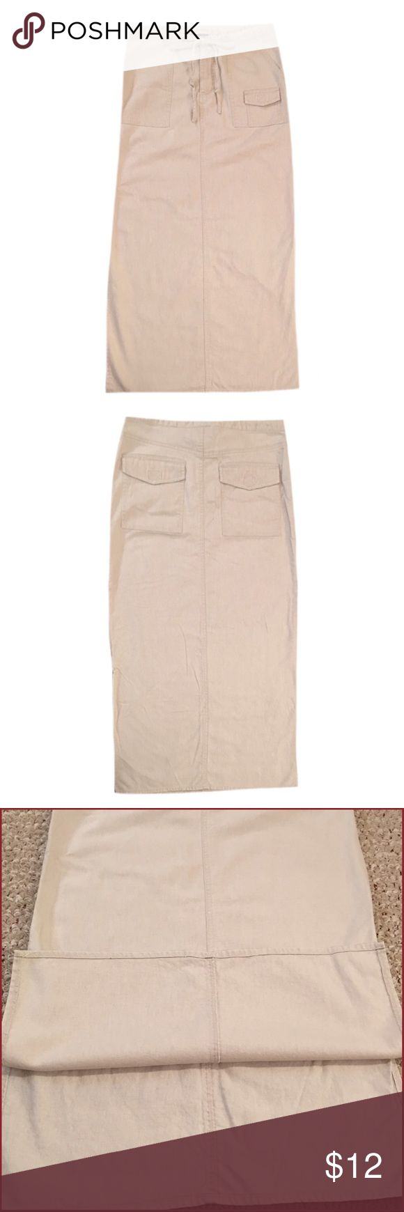 """Jypsy Jeans Long Khaki Skirt Gently used woman's Jypsy Jeans size x-small long khaki skirt. There are slits on both sides of the skirt. Made with 55% Linen and 45% Cotton. Length is 36"""" Jypsy Jeans Skirts"""