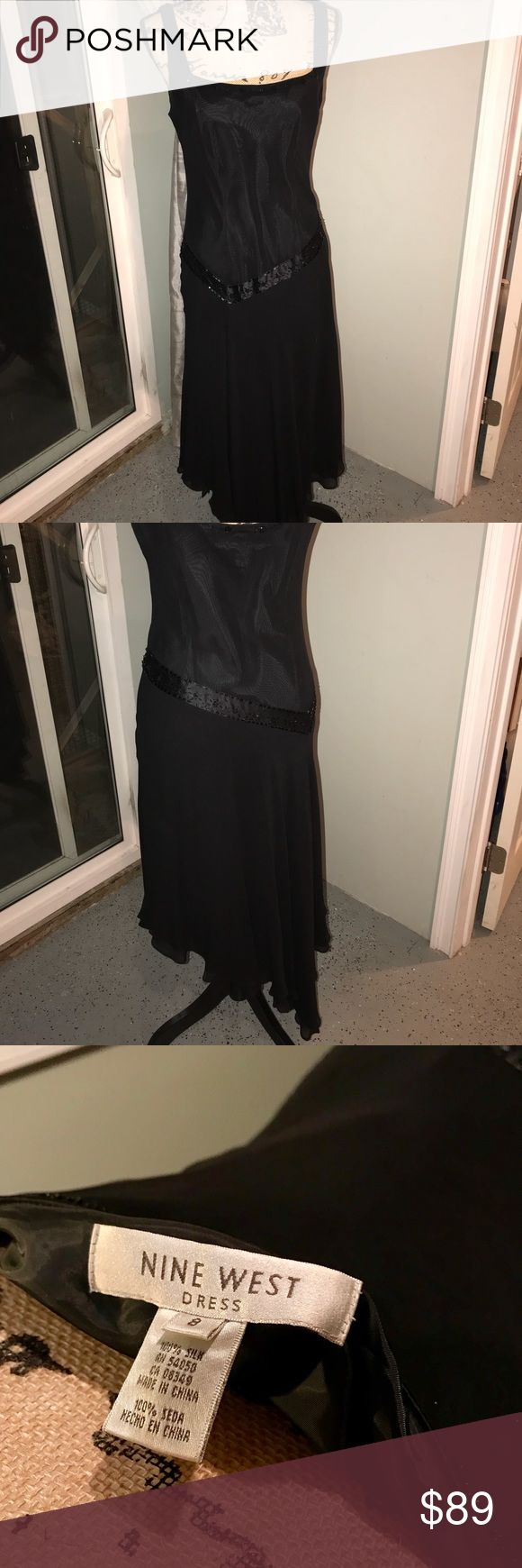 Vintage 30s-style flapper Dress 100% black silk. 30s flapper style cocktail party dress. Drop waist, beaded and asymmetrical handkerchief hem. Skirt is split front and back with a taffeta lining underneath. Nine West Dresses Asymmetrical