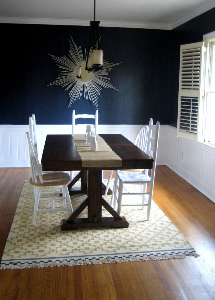 Love the navy walls with white panelling and plantation shutters
