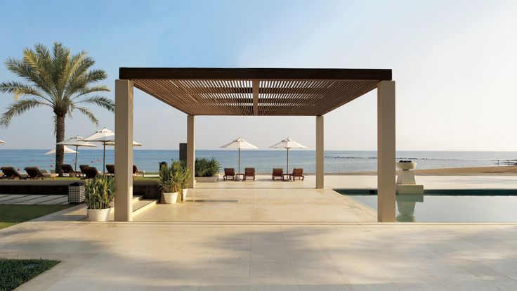 Al Bustan Palace, A Ritz-Carlton Hotel The pool and garden area is the perfect spot to unwind and soak up the sun at Al Bustan Palace, A Ritz-Carlton Hotel.