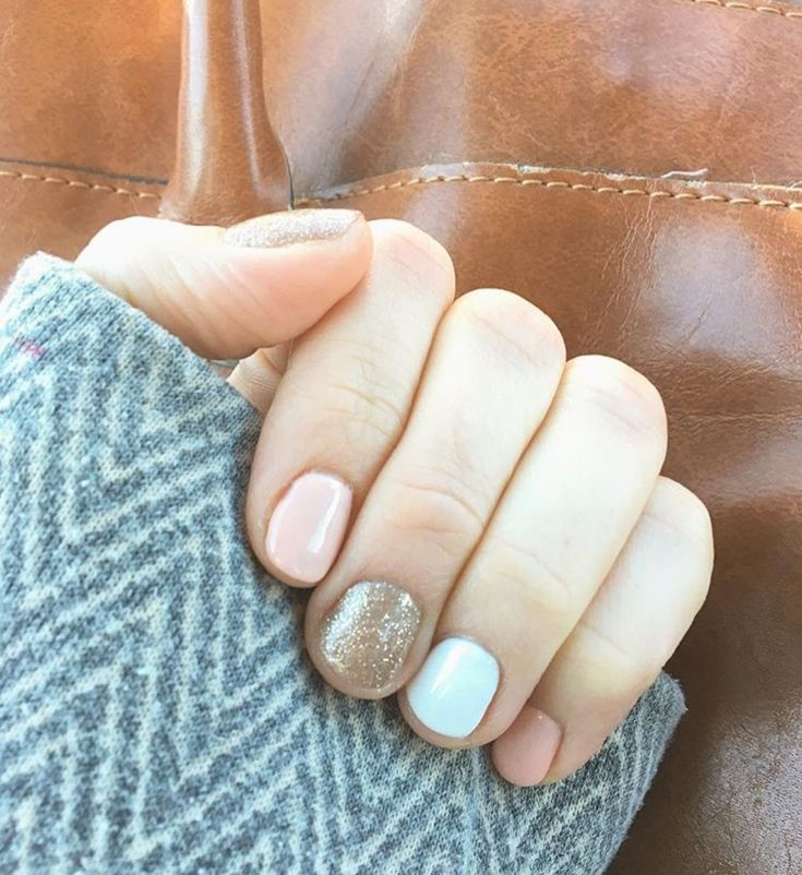 White, pink, and gold shellac nails
