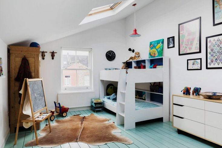 scandinavian kids room with chalkboard square area rugs